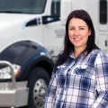 Woman-Trucker-Driver-in-Front-of-Semi-Truck-