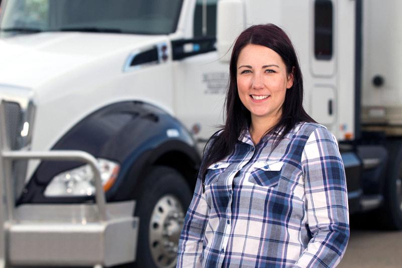 Woman-Trucker-Driver-in-Front-of-Semi-Truck-